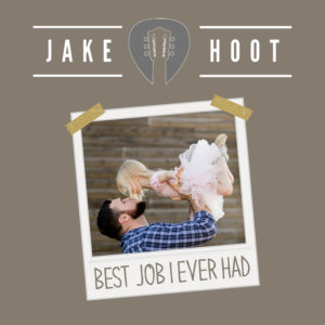 Jake Hoot holding daughter in the air